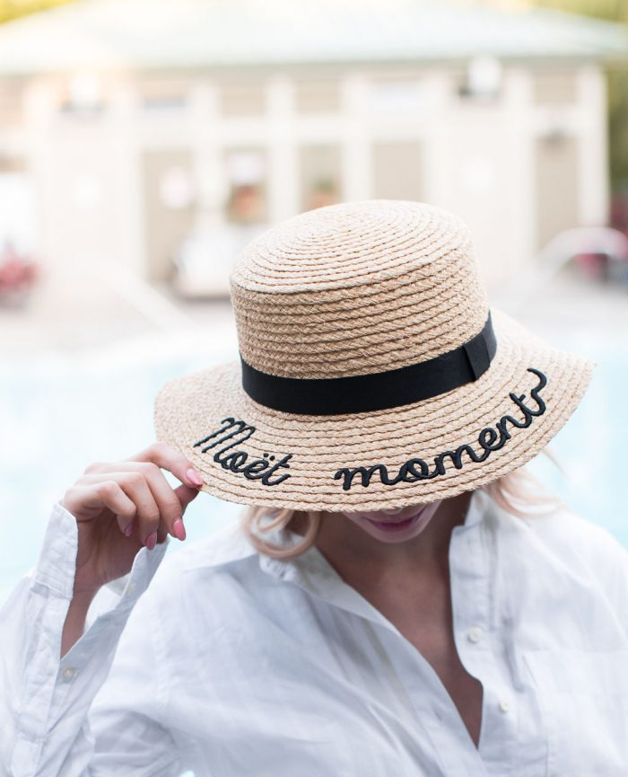 Woman with Moet and Chandon Hat