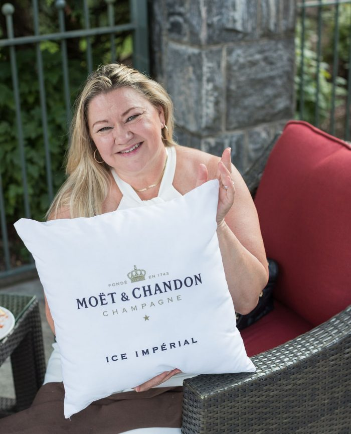 Blond Woman with Moet and Chandon Pillow
