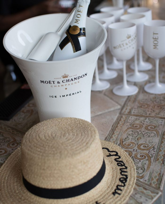 Girl at Moet and Chandon Bottle and Hat